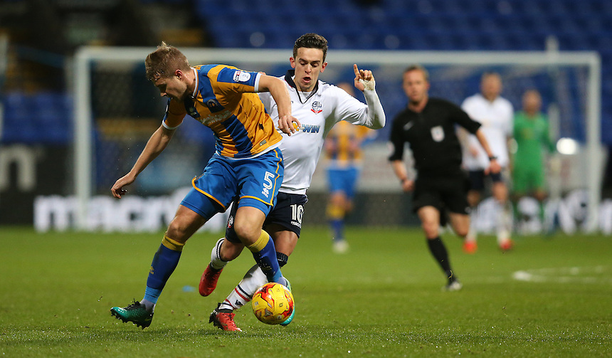 Bolton Wanderers' Zach Clough and Shrewsbury Town's Oliver Lancashire<br /> <br /> Photographer Stephen White/CameraSport<br /> <br /> The EFL Sky Bet League One - Bolton Wanderers v Shrewsbury Town - Monday 26th December 2016 - Macron Stadium - Bolton<br /> <br /> World Copyright &copy; 2016 CameraSport. All rights reserved. 43 Linden Ave. Countesthorpe. Leicester. England. LE8 5PG - Tel: +44 (0) 116 277 4147 - admin@camerasport.com - www.camerasport.com