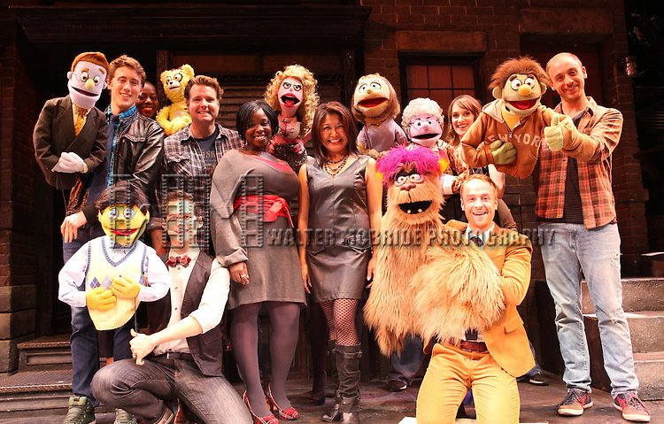 The cast of 'Avenue Q' (L to R)  Darren Bluestone, Robin S. Walker, Jed Resnick, Nicholas Kohn, Danielle K. Thomas, Hazel Anne Raymundo, Veronica Kuehn, Lexy Fridell, Rob Morrison and Michael Liscio Jr. celebrating their 3rd Anniversary Off-Broadway & filming a PSA in support of the Public Broadcasting System at The World Stages on 10/22/2012 in New York City.