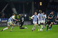 Andre Ayew of Swansea City is fouled by Jon Gorenc Stanković of Huddersfield Town during the Sky Bet Championship match between Huddersfield Town and Swansea City at The John Smith's Stadium in Huddersfield, England, UK. Tuesday 26 November 2019