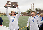 NEW BRITAIN, CT-111817JS05- John Mudgett (14)  heists the championship plaque in front of teammate Nick Lutrzykowski (7)  following their 3-2 win over Suffield to capture the Class M state title Saturday at Willow Brook Park in New Britain.<br /> Jim Shannon Republican-American