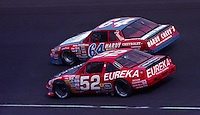 Brad Teague(64) and Jimmy Means compete in the Atlanta Journal 500 at Atlanta International Raceway in Hampton, GA, November 1988.  (Photo by Brian Cleary/www.bcpix.com)