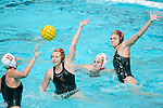LOS ANGELES, CA - MAY 13: Courtney Fahey #7 and Maud Megens #6 of the University of Southern California reach to block a pass attempt by Makenzie Fischer #11 of Stanford University during the Division I Women's Water Polo Championship held at the Uytengsu Aquatics Center on the USC campus on May 13, 2018 in Los Angeles, California. USC defeated Stanford 5-4. (Photo by Tim Nwachukwu/NCAA Photos via Getty Images)
