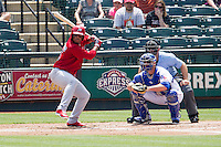 Memphis Redbirds outfielder Oscar Taveras #15 at bat during the Pacific Coast League baseball game against the Round Rock Express on April 27, 2014 at the Dell Diamond in Round Rock, Texas. The Express defeated the Redbirds 6-2. (Andrew Woolley/Four Seam Images)