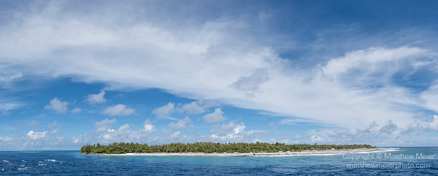 Rangiroa Atoll, Tuamotu Archipelago, French Polynesia; a panoramic view of Tiputa Pass and the eastern edge of Avatoru Island in early morning sunlight from inside the channel on Rangiroa Atoll