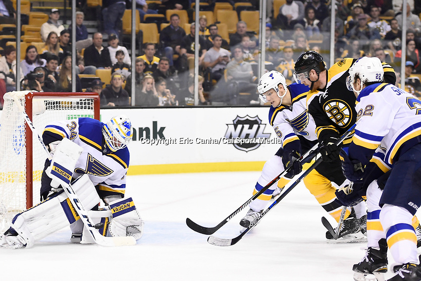 Tuesday, December 22, 2015: St. Louis Blues goalie Jake Allen (34) makes a save as Boston Bruins right wing Jimmy Hayes (11) looks for the rebound during the National Hockey League game between the St. Louis Blues and the Boston Bruins held at TD Garden, in Boston, Massachusetts. The blues beat the Bruins 2-0 in regulation time. Eric Canha/CSM