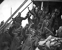 "The famous 369th arrive in N.Y. City.  Members of the 369th Colored Inf., formerly 15th N.Y. regulars.  ""Back to little old New York"".  1919.  Paul Thompson. (War Dept.)<br />
