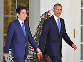 United States President Barack Obama, left, and Prime Minister Shinzo Abe of Japan, right, leave the Oval Office to conduct a joint press conference in the Rose Garden of the White House in Washington, D.C. on Tuesday, April 28, 2015.<br /> Credit: Ron Sachs / CNP