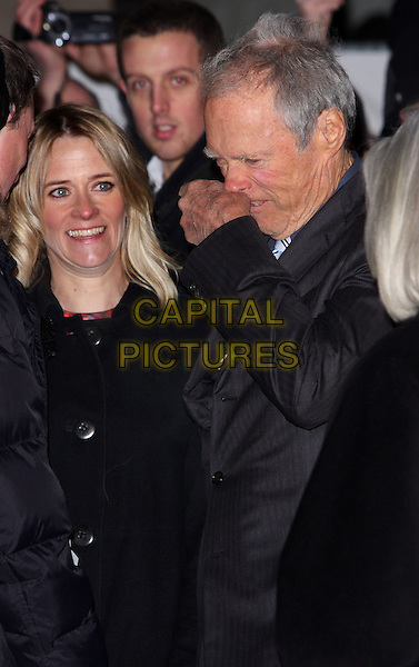 "EDITH BOWMAN & CLINT EASTWOOD.Attending the ""Invictus'"" UK Film Premiere at the Odeon West End cinema, Leicester Square, London, England, January 31st, 2010..arrivals half length grey gray hand black profile wiping nose funny pinstripe suit jacket coat .CAP/ROS.©Steve Ross/Capital Pictures"