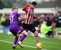 Lincoln City's Tom Pett vies for possession with Grimsby Town's Luke Hendrie<br /> <br /> Photographer Chris Vaughan/CameraSport<br /> <br /> The EFL Sky Bet League Two - Lincoln City v Grimsby Town - Saturday 19 January 2019 - Sincil Bank - Lincoln<br /> <br /> World Copyright © 2019 CameraSport. All rights reserved. 43 Linden Ave. Countesthorpe. Leicester. England. LE8 5PG - Tel: +44 (0) 116 277 4147 - admin@camerasport.com - www.camerasport.com