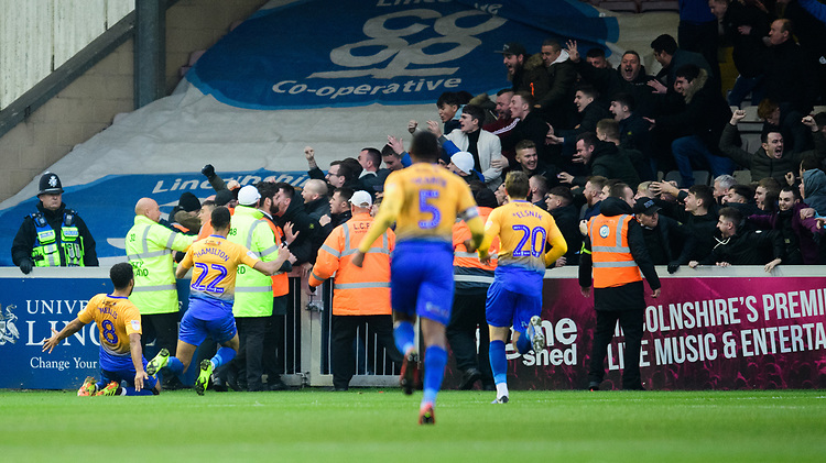 Mansfield Town's Jacob Mellis, left, celebrates scoring his side's equalising goal to make the score 1-1<br /> <br /> Photographer Chris Vaughan/CameraSport<br /> <br /> The EFL Sky Bet League Two - Lincoln City v Mansfield Town - Saturday 24th November 2018 - Sincil Bank - Lincoln<br /> <br /> World Copyright © 2018 CameraSport. All rights reserved. 43 Linden Ave. Countesthorpe. Leicester. England. LE8 5PG - Tel: +44 (0) 116 277 4147 - admin@camerasport.com - www.camerasport.com