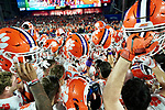 Clemson Tigers players hold their helmets in the air after breaking a huddle before the Fiesta Bowl game against the Ohio State Buckeyes on Saturday, Dec 28, 2019 in Glendale, Ariz.  (Gene Lower via AP)