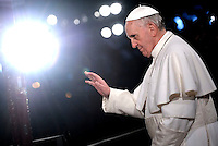 Pope Francis holds the wooden cross during the Via Crucis (Way of the Cross) torchlight procession on Good Friday in front of the Colosseum in Rome.March 29, 2012