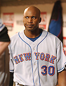 Washington, D.C. - April 29, 2005 -- New York Mets outfielder Cliff Floyd (30) walks unhappily through the Mets dugout after the game against the Washington Nationals at RFK Stadium in Washington, D.C. on April 29, 2005.  The game marks the Mets first-ever regular - season appearance in Washington.  The Nationals won the game, 5 - 1..Credit: Ron Sachs / CNP.(RESTRICTION: NO New York or New Jersey Newspapers or newspapers within a 75 mile radius of New York City)