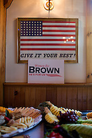 "A campaign sign for Senator Scott Brown (R-MA) hangs on a wall above food at a ""Women For Brown"" meet and greet at The Olde Post Office Pub in North Grafton, Massachusetts, USA, on Thurs., Nov. 2, 2012. Senator Scott Brown is seeking re-election to the Senate.  His opponent is Elizabeth Warren, a democrat."
