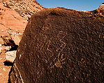 Anthropomorphic figures chiseled on a boulder near Mexican Mountain on the San Rafael Swell in Utah.  These petroglyphs were carved into the rock between 800 and 1,500 years ago.