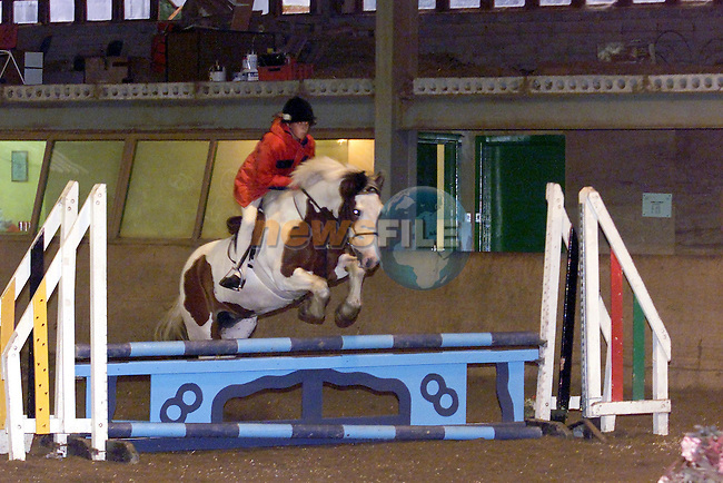 Rachel Loftus jumping fence no 8 in castle hill equestrian centre..Picture Fran Caffrey Newsfile...This Picture is sent to you by:..Newsfile Ltd.The View, Millmount Abbey, Drogheda, Co Louth, Ireland..Tel: +353419871240.Fax: +353419871260.GSM: +353862500958.ISDN: +353419871010.email: pictures@newsfile.ie.www.newsfile.ie