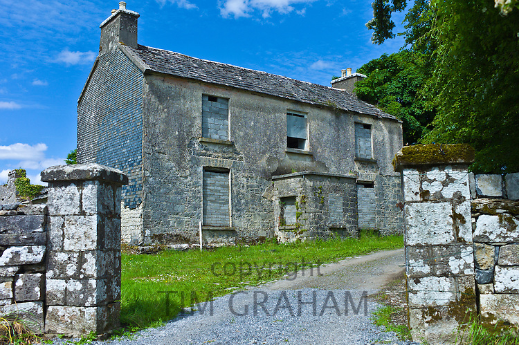 Derelict two-storey old rectory house in rural setting, Kilfenora, County Clare, West of Ireland