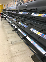 Pictured: Empty shelves in the Tesco super market store in Merthyr Tydfil, Wales, UK<br /> Re: A Tesco super market store had to close at 5pm on Saturday in Merthyr Tydfil, after most of its shelves were stripped by shoppers fearing that the weather caused by Storm Emma and the Beast from the East would get worse.