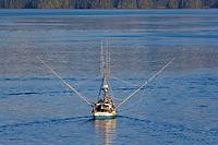 "Commercial trolling vessel ""Moonlight"" passes through Sitka Sound, southeast, Alaska."