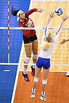 KANSAS CITY, MO - DECEMBER 16: Jazz Sweet (12) of the University of Nebraska spikes the ball past Carli Snyder (4) of the University of Florida during the Division I Women's Volleyball Championship held at Sprint Center on December 16, 2017 in Kansas City, Missouri. (Photo by Jamie Schwaberow/NCAA Photos via Getty Images)