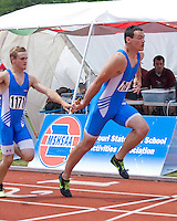 Zach Crites hands off the baton to Brad Wolf in the Class 3 4x200 relay where they finished 7th in 1:31.36.