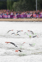 07 AUG 2012 - LONDON, GBR - Richard Varga (SVK) of Slovakia leads competitors to the swim exit during the men's London 2012 Olympic Games Triathlon  in Hyde Park, London, Great Britain (PHOTO (C) 2012 NIGEL FARROW)