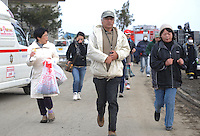 People run away from the coast after a Tsunami warning alert in the  town of Natori, after the Tsunami devastated the entire pacifc coastline of Japan after the earthquake and tsunami devastated the area Sendai, Japan..14 Mar 2011..