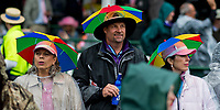 LOUISVILLE, KY - MAY 05: Spectattore where umbrella hats to escape the rain on Kentucky Oaks Day at Churchill Downs on May 5, 2017 in Louisville, Kentucky. (Photo by Douglas DeFelice/Eclipse Sportswire/Getty Images)