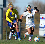 SIOUX FALLS, SD - NOVEMBER 7:  Amy Yang #10 from NDSU controls the ball in front of Tori Poole #21 from SDSU in the first half of the Summit League Championship Soccer match Saturday at Fischback Soccer Field in Brookings. (Photo by Dave Eggen/Inertia)