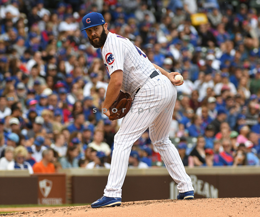 CHICAGO IL - May 21, 2017: Jake Arrieta #49 of the Chicago Cubs during a game against the Milwaukee Brewers on May 21, 2017 at Wrigley Field in Chicago, IL. The Cubs beat the Brewers 13-6.(David Durochik/ SportPics)