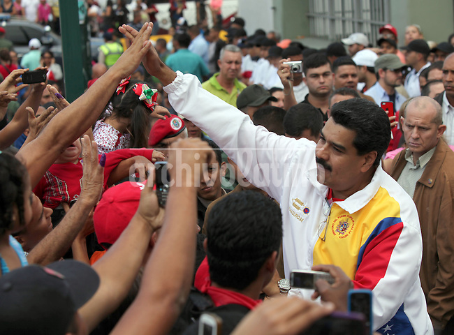 Venezuela's President Nicolas Maduro casts his ballot during municipal elections in Caracas December 8, 2013. Venezuelans vote in municipal elections on Sunday that are the biggest political test yet for President Nicolas Maduro as he tries to halt an economic slide and preserve the radical socialist legacy of his late mentor Hugo Chavez.<br /> Maduro got the majority of votes by lost the control of the more important cities of Venezuela.