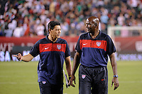 United States assistant coach Martin Vasquez (L) talks with goalkeeper coach Mike Curry (R) after the match. The men's national teams of the United States (USA) and Mexico (MEX) played to a 1-1 tie during an international friendly at Lincoln Financial Field in Philadelphia, PA, on August 10, 2011.