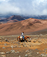 A horseback rider on a trail in Haleakala National Park, Maui.