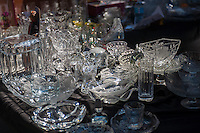 "Cut glass tchotkes for sale at the Brighton Beach Jubilee in the Brighton Beach neighborhood of Brooklyn in New York on Sunday, August 25, 2013. The neighborhood is sometimes colloquially named ""Little Odessa"" because of its popularity amongst Russian emigres and its proximity to the ocean. (© Richard B. Levine)"