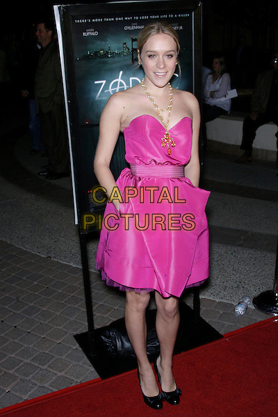 "CHLOE SEVIGNY.""Zodiac"" Los Angeles Premiere - Arrivals held at Paramount Theatre, California, USA..March 1st, 2007.full length pink dress hands in pockets strapless gold necklace black shoes.CAP/ADM/ZL.©Zach Lipp/AdMedia/Capital Pictures"