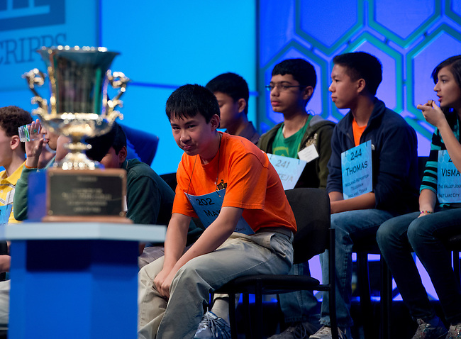 Speller 202 Max Lee eyes the trophy during a break in the semi-final rounds of the Scripps National Spelling Bee at the Gaylord National Resort and Convention Center in Oxon Hill, Md., on Thursday,  May 31, 2012. Photo by Bill Clark