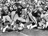 Oakland Raider runner Mark Van Eeghen with block by #78 Art Shell against the Seattle Seahawks. (1980 photo by Ron Riesterer)