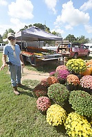NWA Democrat-Gazette/FLIP PUTTHOFF <br />SIGNS OF THE SEASON<br />Jake Kettner of Sulphur Springs shows Wednesday Sept. 12 2018 mums and pumpkins he sells at his vegetable stand along Arkansas 72 in Hiwasse. Kettner sells vegetables through the summer but offers fall items as autumn approaches. Autumn begins on Sept. 22.