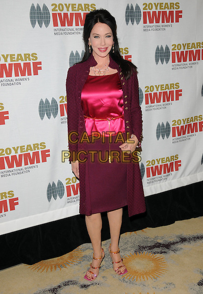 HUNTER TYLO .at The 2009 Courage in Journalism Awards held at The Beverly Hills Hotel in Beverly Hills, California, USA,.October 28th 2009..full length pink silk satin top skirt coat maroon sandals jewelled beaded open toe strappy waist belt gold                                                                  .CAP/RKE/DVS .©DVS/RockinExposures/Capital Pictures