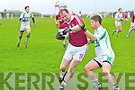 Veteran James O'Sullivan for Dromid fends off the challenge of Kanturk's Lorcan O'Neill in extra time at the Munster Semi-Final of the Junior Club Championship in Waterville on Sunday.