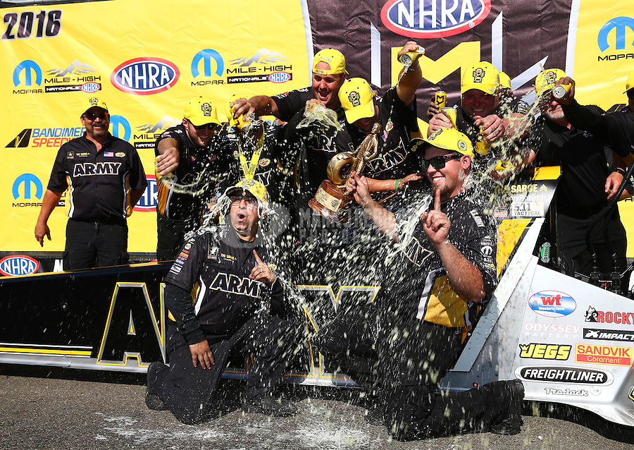 Jul 24, 2016; Morrison, CO, USA; Crew members douse each other with Mello Yello as NHRA top fuel driver Tony Schumacher celebrates after winning the Mile High Nationals at Bandimere Speedway. Mandatory Credit: Mark J. Rebilas-USA TODAY Sports
