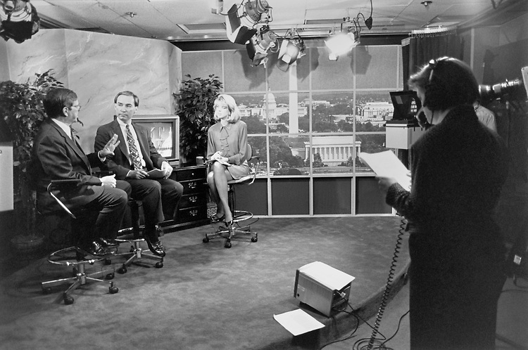 "Sen. Pietro Vichi ""Pete"" Domenici, R-N.M., during live broadcast in Republican Conference studio Wednesday morning. Sen. Kelly D. Johnston, Okla., and Elizabeth Morra Co-hosts of show. October 13, 1993 (Photo by Maureen Keating/CQ Roll Call)"