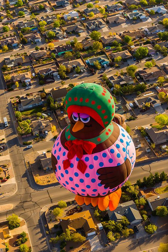 A special shapes hot air balloon flying during the Albuquerque International Balloon Fiesta, Albuquerque, New Mexico USA.