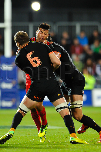 15.04.2016. Christchurch, New Zealand.  Richie Mo'unga of the Crusaders is tackled by Rodrigo Baez  and Guido Petti of the Jaguares during the Super Rugby Match, Crusaders V Jaguares, AMI Stadium, Christchurch, New Zealand. 15th April 2016.