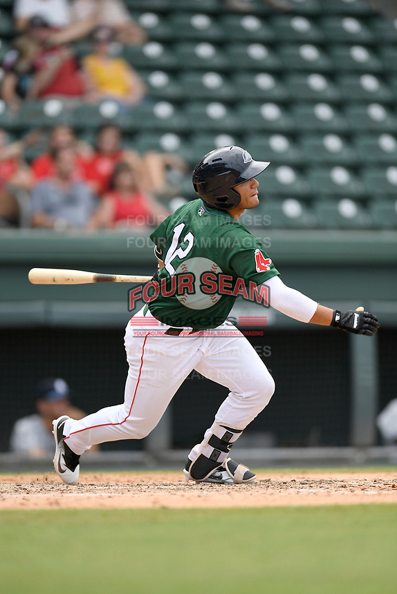 Designated hitter Frankie Rios (12) of the Greenville Drive bats in a game against the Asheville Tourists on Sunday, June 3, 2018, at Fluor Field at the West End in Greenville, South Carolina. Greenville won, 7-6. (Tom Priddy/Four Seam Images)