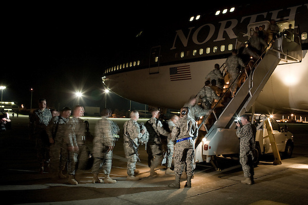 April 16, 2009. Pope Air Force Base, NC.. Members of the North Carolina National Guard's 30th Brigade Heavy Combat Team leave Pope Air Force Base for a 12 month tour in Iraq. In all, approximately 4,000 soldiers from the 30th HBCT are deploying and this will be the Brigade's 2nd deployment since 2003.. Members of B Company 230th BSB, headquartered in Dunn and F Company 230th BSB, headquartered in Red Springs load ontot he plane.