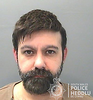 Financial adviser Tony Richards, 39, jailed after being caught using his mobile phone to secretly film sexual encounters with call girls in Cardiff, Wales, UK.