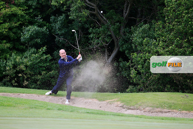 Joe Lyons (Galway) plays out of a bunker on the 17th during Round 3 of the Irish Mid-Amateur Open Championship at New Forest on Sunday 21st June 2015.<br /> Picture:  Thos Caffrey / www.golffile.ie