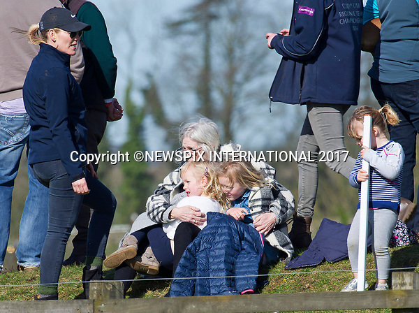 25.03.2017; Gatcombe, UK: PETER &amp; AUTUMN PHILLIPS<br /> with daughters Savannah and Isla and Mia Tindall at the Gatcombe Horse Trials.<br /> The 2-day horse trials are held on Princess Anne&rsquo;s estate in Minchinhampton, Gloucestershire.<br /> Picture shows: The girls cuddle up to their grandmother Kathleen McCarthy<br /> Mandatory Photo Credit: &copy;Francis Dias/NEWSPIX INTERNATIONAL<br /> <br /> IMMEDIATE CONFIRMATION OF USAGE REQUIRED:<br /> Newspix International, 31 Chinnery Hill, Bishop's Stortford, ENGLAND CM23 3PS<br /> Tel:+441279 324672  ; Fax: +441279656877<br /> Mobile:  07775681153<br /> e-mail: info@newspixinternational.co.uk<br /> Usage Implies Acceptance of OUr Terms &amp; Conditions<br /> Please refer to usage terms. All Fees Payable To Newspix International