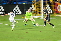 CARSON, CA - SEPTEMBER 15: Cristian Pavon #10 of the Los Angeles Galaxy takes a scoring shot on goal past Graham Smith #16 and Tim Melia #29 of Sporting Kansas City during a game between Sporting Kansas City and Los Angeles Galaxy at Dignity Health Sports Complex on September 15, 2019 in Carson, California.